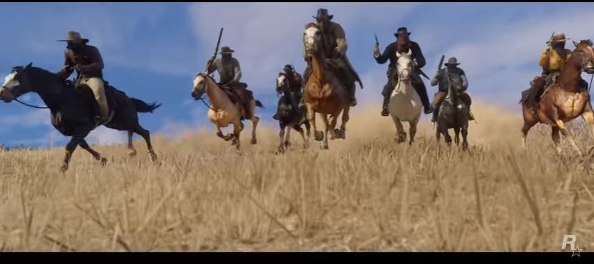 Pandilla montando caballos. ¿Podrá ser la pandilla de John Marston? Fotocaptura, Trailer Red Dead Redemption 2